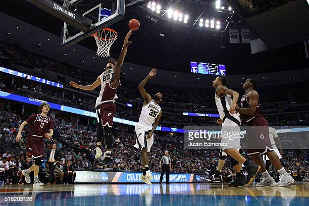 J Hammons of the Purdue Boilermakers blocks a shot by Josh Hagins of the Arkansas Little Rock Trojans during the first round of the 2016 NCAA Men's...