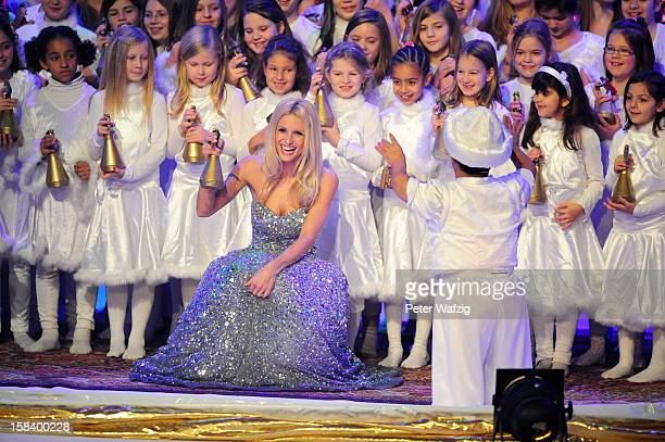 Hammou Bensalah performs with jury member Michelle Hunziker during the 'Das Supertalent' Finals on December 15 2012 in Cologne Germany