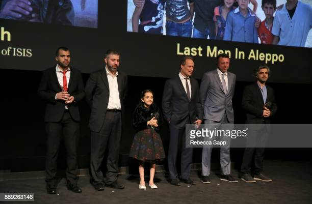 Hamoud AlMousa Evgeny Afineevsky Bana alAbed Sebastian Junger Nick Quested and Firas Fayyad at the 33rd Annual IDA Documentary Awards at Paramount...