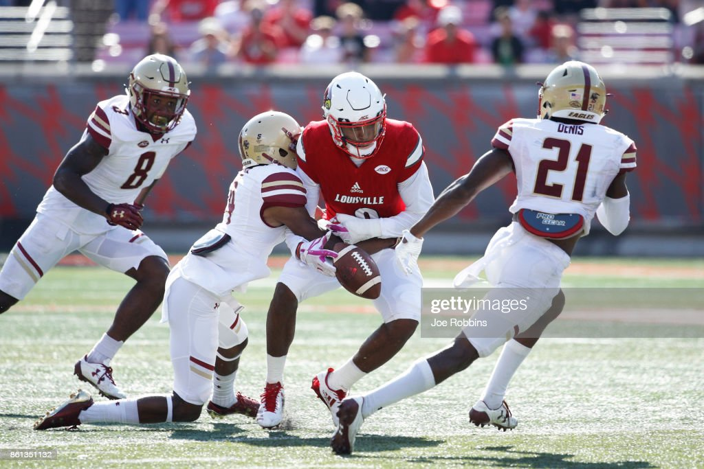 Hamp Cheevers #4 of the Boston College Eagles forces a fumble from Jaylen Smith #9 of the Louisville Cardinals to set up the game-winning field goal in the fourth quarter of a game at Papa John's Cardinal Stadium on October 14, 2017 in Louisville, Kentucky. Boston College won 45-42.