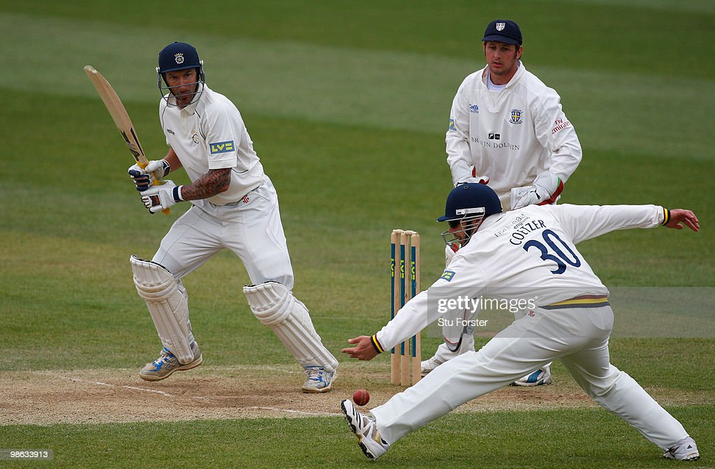 Hampshire batsman Nic Pothas pushes the ball past fielder Kyle Coetzer to pick up some runs as Phil Mustard looks on during day three of the LV County Championship division one match between Durham and Hampshire at The Riverside on April 22, 2010 in Chester-le-Street, England.