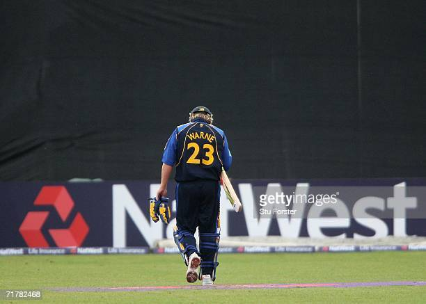 Hampshire batsman Shane Warne heads back to the pavillion after being run out first ball during the NatWest Pro40 day/night game between...
