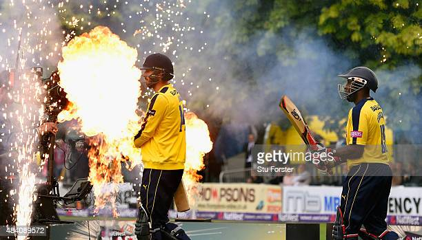 Hampshire batsmen Michael Carberry and James Vince make their way to the middle before the NatWest T20 Blast quarter final match between...