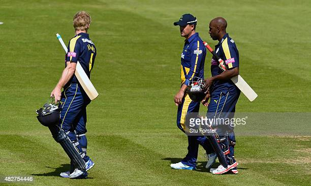 Hampshire batsmen Michael Carberry and Jimmy Adams chat to Glamorgan captain Jacques Rudolph as they leave the pitch after both Hampshire openers...