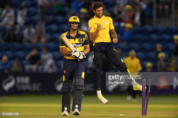 Hampshire bowler Reece Topley celebrates as Glamorgan batsman Marchant de Lange leaves the field during the NatWest T20 Blast match between Glamorgan...