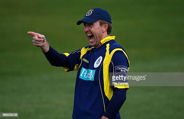 Hampshire fielder Dominick Cork shares a joke with a spectator during the Clydesdale Bank 40 match between Durham Dynamos and Hampshire Royals at The...
