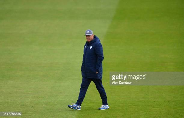 Hampshire Head Coach, Adrian Birrell inspects the outfield as rain delays the start of play on Day One of the LV= Insurance County Championship match...
