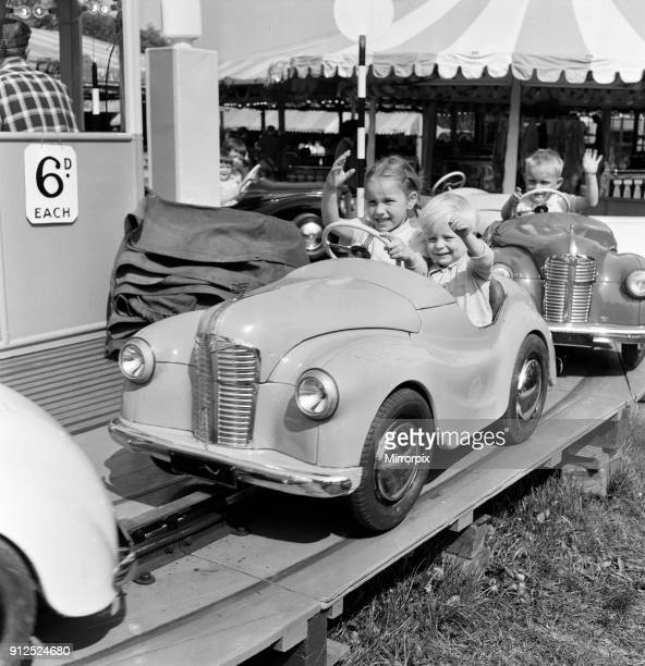 Hampstead Heath Fair. Jane and Peter Hindley of Highgate on a motor roundabout, 16th May 1959.