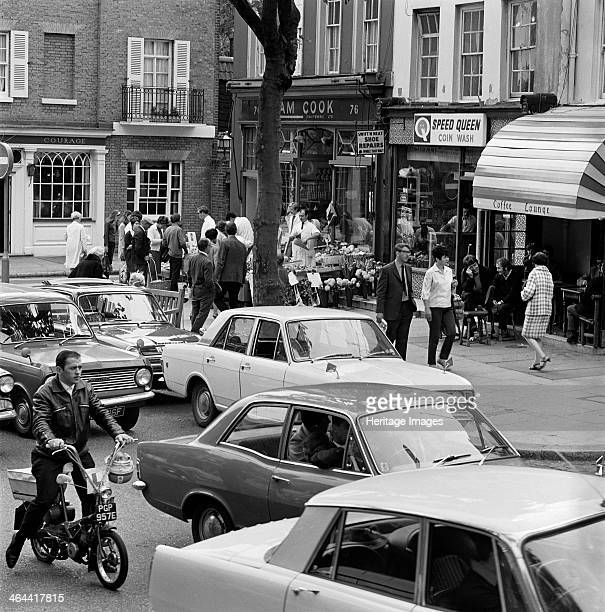 Hampstead High Street Hampstead London 19671970 Traffic in the high street with a crowd of people gathered around the display outside the...