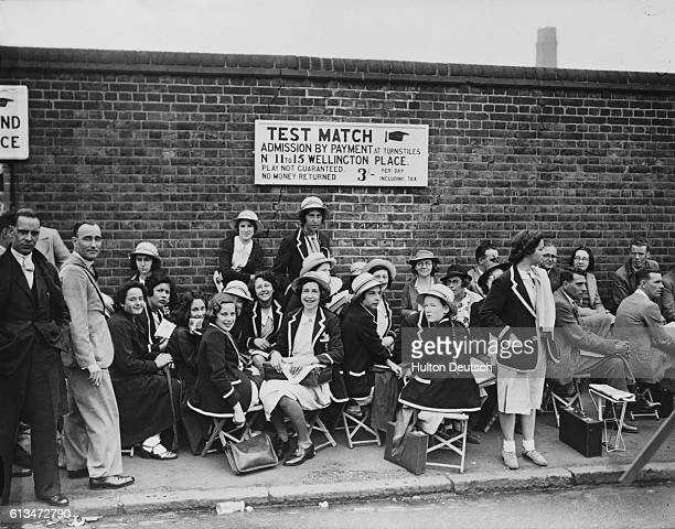 Hampstead schoolgirls queue for entry to the second day's play in the second Test cricket match between England and Australia at London's Lord's...