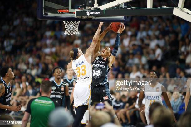 Hampton of the Breakers goes to the basket against E.J. Singler of the Bullets during the round 15 NBL match between the New Zealand Breakers and the...