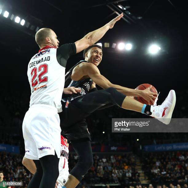 Hampton of the Breakers shoots under pressure from Tim Coenraad of Illawarra during the round four NBL match between the New Zealand Breakers and the...