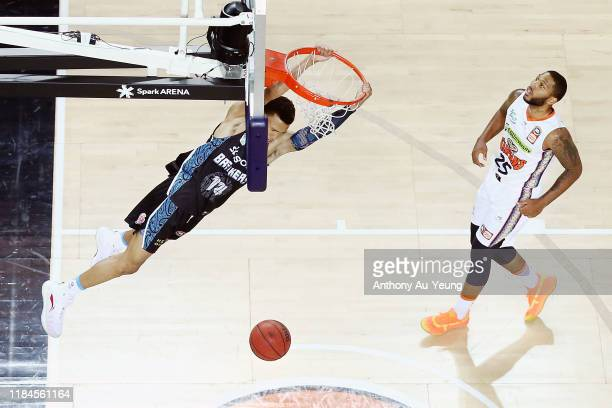 Hampton of the Breakers with a dunk as DJ Newbill of the Taipans looks on during the round five NBL match between the New Zealand Breakers and the...