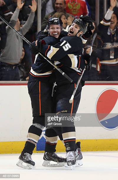 Hampus Lindholm and Ryan Getzlaf of the Anaheim Ducks celebrate Getzlaf's game winning goal in overtime against the Tampa Bay Lightning at Honda...
