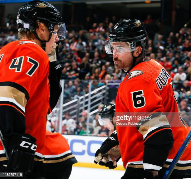 Hampus Lindholm and Erik Gudbranson of the Anaheim Ducks talk during the second period of the game against the Chicago Blackhawks at Honda Center on...