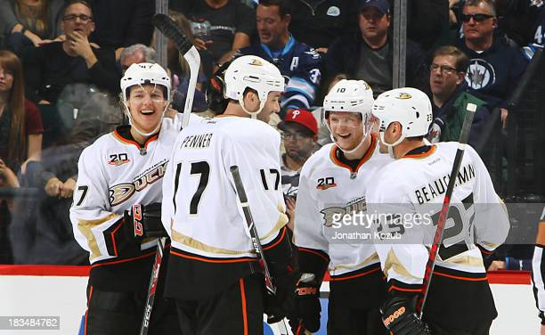 Hampus Lindholm Dustin Penner Corey Perry and Francois Beauchemin of the Anaheim Ducks celebrate a third period goal against the Winnipeg Jets at the...