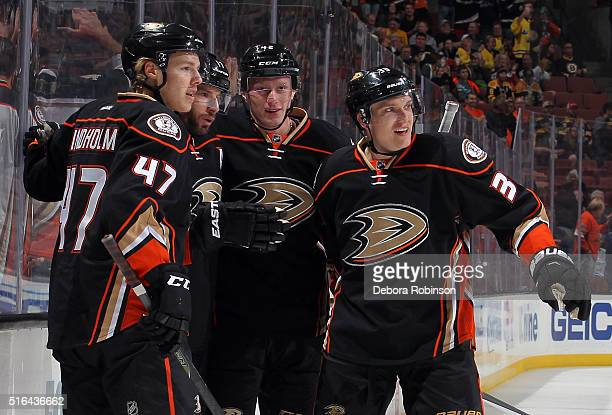 Hampus Lindholm Jakob Silfverberg right and Josh Manson second from right of the Anaheim Ducks celebrate a goal by Ryan Kesler against the Boston...