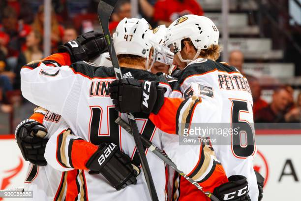 Hampus Lindholm Marcus Pettersson and teammates of the Anaheim Ducks celebrate in an NHL game on March 21 2018 at the Scotiabank Saddledome in...