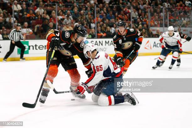 Hampus Lindholm of the Anaheim Ducks and Andre Burakovsky of the Washington Capitals fight for control of the puck during the second period at Honda...