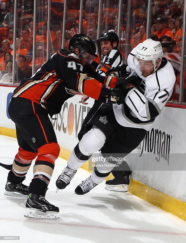 Hampus Lindholm #47 of the Anaheim Ducks and Jeff Carter #77 of the Los Angeles Kings battle for position in Game One of the Second Round of the 2014 Stanley Cup Playoffs at Honda Center on May 3, 2014 in Anaheim, California.
