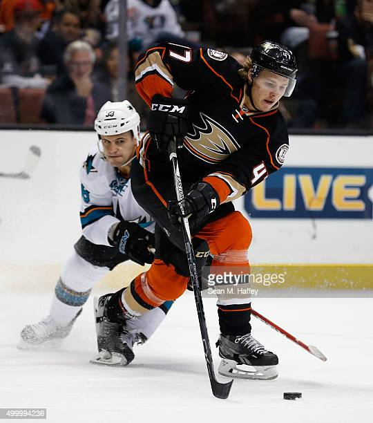 Hampus Lindholm of the Anaheim Ducks battles with Micheal Haley of the San Jose Sharks during the second period at Honda Center on December 4 2015 in...