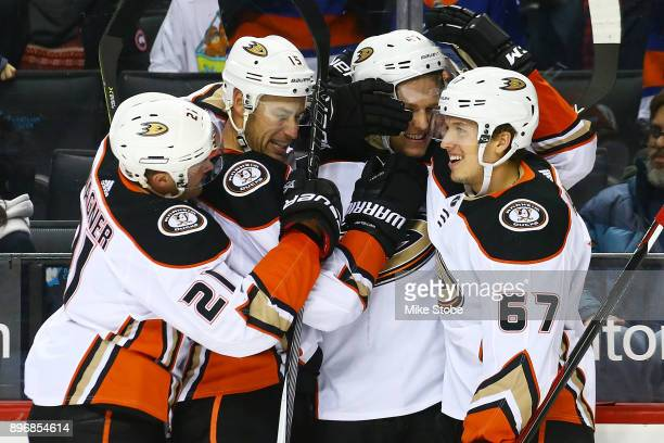Hampus Lindholm of the Anaheim Ducks celebrates his gamewinning goal in overtime against the New York Islanders with teammates Chris Wagner Ryan...