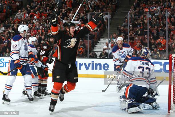 Hampus Lindholm of the Anaheim Ducks celebrates his goal in the first period against Cam Talbot and Zack Kassian of the Edmonton Oilers during the...