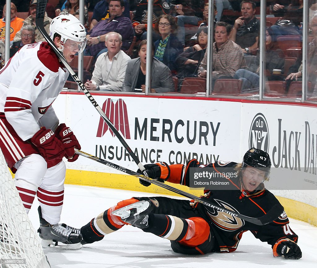 Hampus Lindholm #47 of the Anaheim Ducks collides with Connor Murphy #5 of the Arizona Coyotes on November 7, 2014 at Honda Center in Anaheim, California.