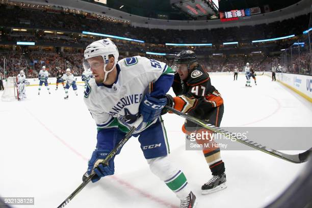 Hampus Lindholm of the Anaheim Ducks defends against Alex Biega of the Vancouver Canucks during the first period of a game at Honda Center on March...