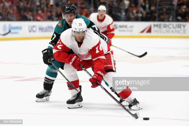 Hampus Lindholm of the Anaheim Ducks defends against Andreas Athanasiou of the Detroit Red Wings during the third period of a game at Honda Center on...