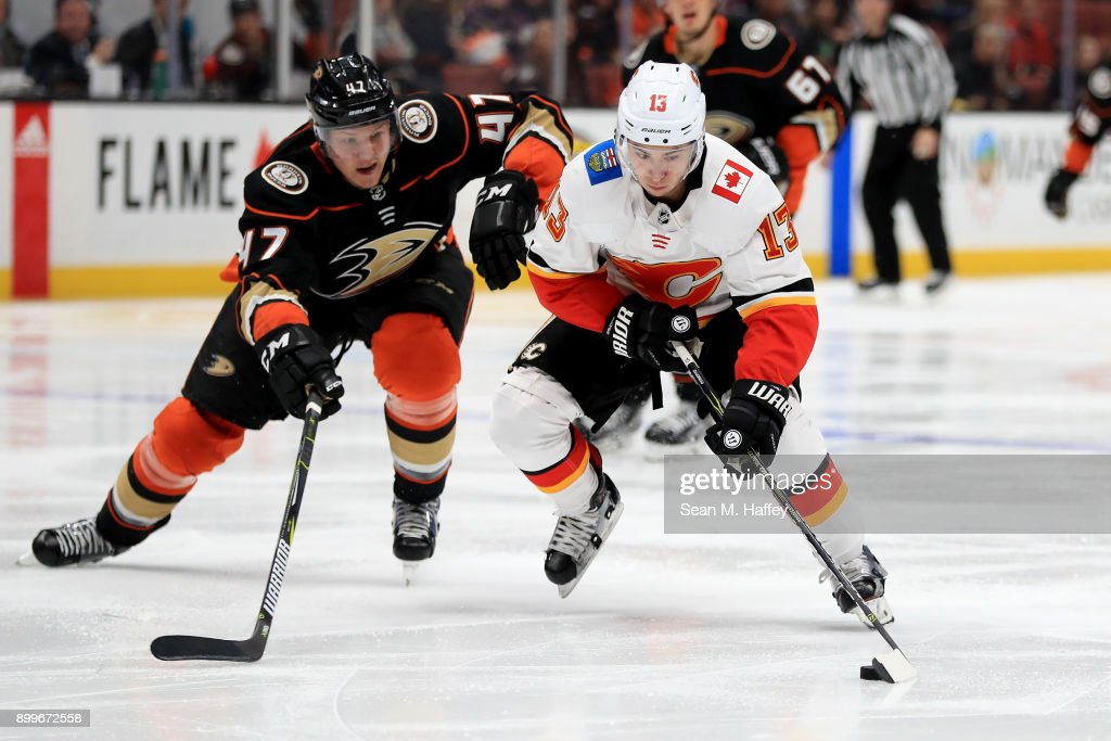 Hampus Lindholm #47 of the Anaheim Ducks defends against Johnny Gaudreau #13 of the Calgary Flames during the second period of a game at Honda Center on December 29, 2017 in Anaheim, California.