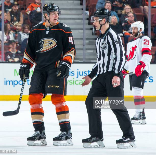Hampus Lindholm of the Anaheim Ducks protests as he is mistakenly escorted to the penalty box by linesman Travis Gawryletz during the first period of...
