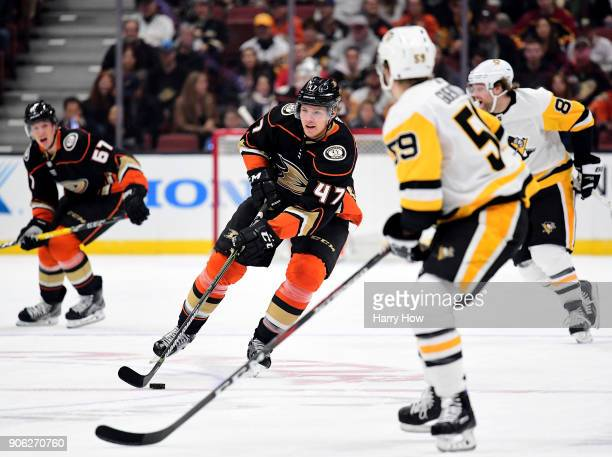 Hampus Lindholm of the Anaheim Ducks rushes the puck in front of Jake Guentzel of the Pittsburgh Penguins during the first period at Honda Center on...