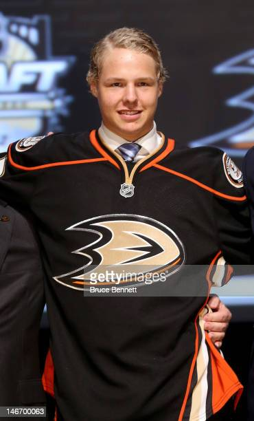 Hampus Lindholm sixth overall pick by the Anaheim Ducks poses on stage during Round One of the 2012 NHL Entry Draft at Consol Energy Center on June...