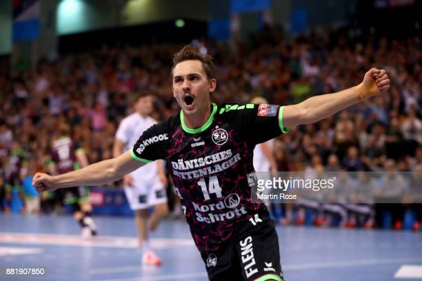 Hampus Wanne of Flensburg Handewitt celebrates after scoring a goal during the Velux EHF Champions League match between SG Flensburg Handewitt and...