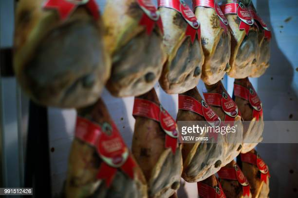 Hams hang on a wall during The Summer Fancy Food Show at the Javits Center in the borough of Manhattan on July 02 2018 in New York The Summer Fancy...