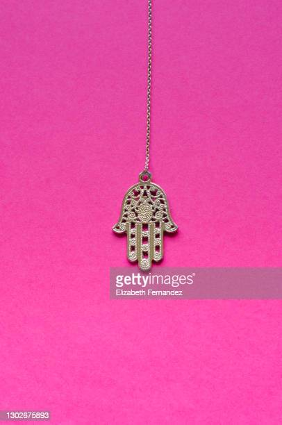 'hamsa', the hand for good luck or the hand of fatima, on pink background - necklace stock pictures, royalty-free photos & images