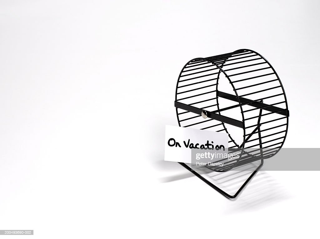Hamster wheel with 'on vacation' sign, close-up : Stock Photo