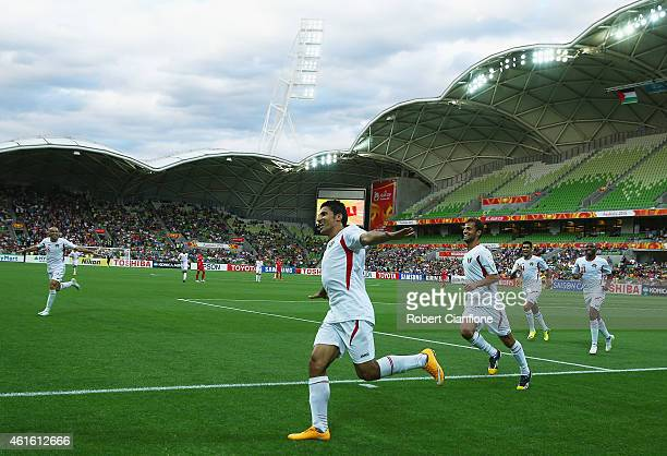 Hamza Al Dardour of Jordan celebrates after he scored his third goal of the match during the 2015 Asian Cup match between Palestine and Jordan at...