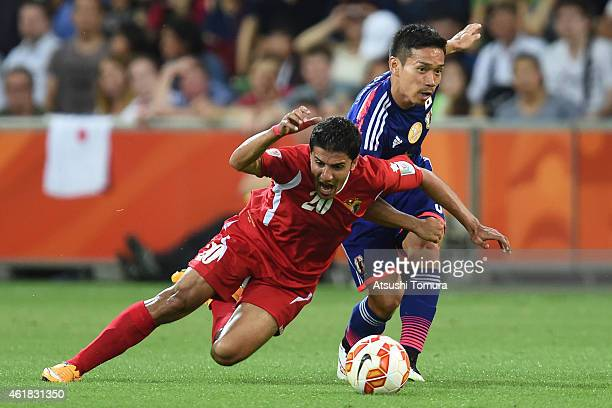 Hamza Aldaradreh of Jordan and Yuto Nagatomo of Japan compete for the ball during the 2015 Asian Cup match between Japan and Jordan at AAMI Park on...