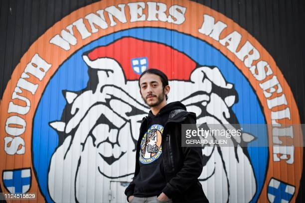 Hamza Baggour 'capo' of the biggest group of fans of Olympique de Marseille football club poses at the headquarters of the South Winners association...