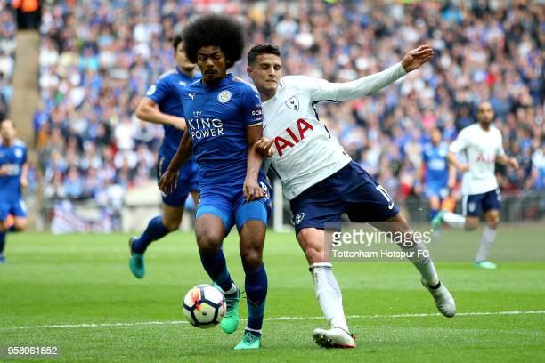 Hamza Choudhury of Leicester City battles for possession with Erik Lamela of Tottenham Hotspur during the Premier League match between Tottenham...