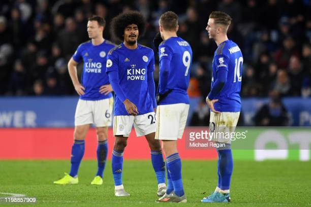 Hamza Choudhury of Leicester City reacts with teammates Jamie Vardy and James Maddison after conceding a second goal during the Premier League match...