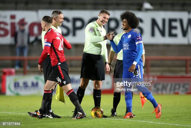 Hamza Choudhury of Leicester City shakes hands with referee Robert Jones ahead of the Checkatrade Trophy tie between Morecambe and Leicester City at...