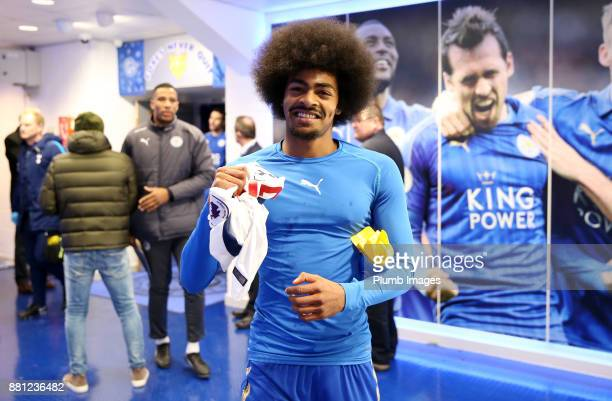 hamza Choudhury of Leicester with Erik Lamela of Tottenham Hotspur's shirt after making his Premier League debut during the Premier League match...