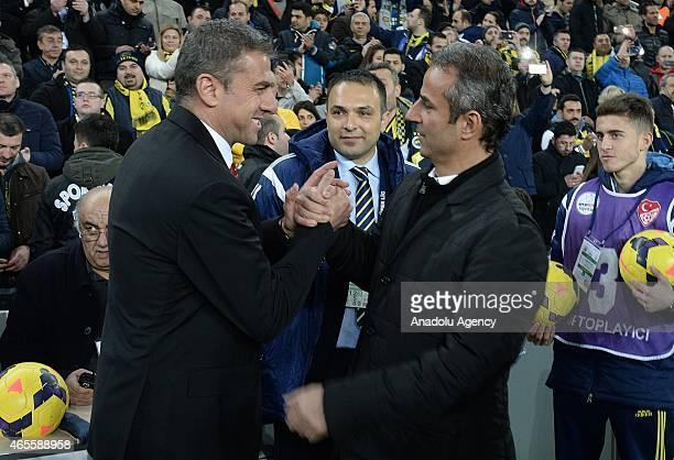 Hamza Hamzaoglu head coach of Galatasaray and Ismail Kartal head coach of Fenerbahce shake hands ahead of Turkish Spor Toto League match between...