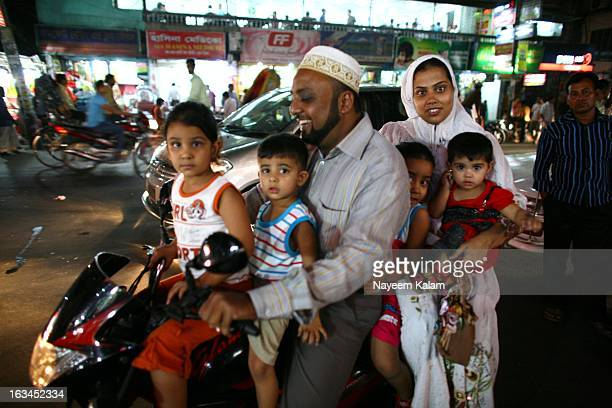 Hamza, his wife and four children. Two of them belong to his brother. He is from the local Gujarati community who are originally from India, used to...