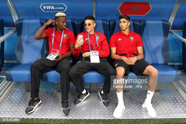 Hamza Mendyl Amine Harit and Achraf Hakimi of Morocco speak ahead of during the 2018 FIFA World Cup Russia group B between Morocco and Iran at Saint...