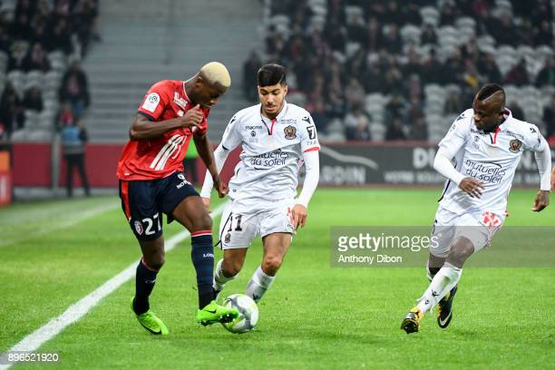 Hamza Mendyl of Lille Bassem Srarfi of Nice and Jean Michael Seri of Nice during the Ligue 1 match between Lille OSC and OGC Nice at Stade Pierre...