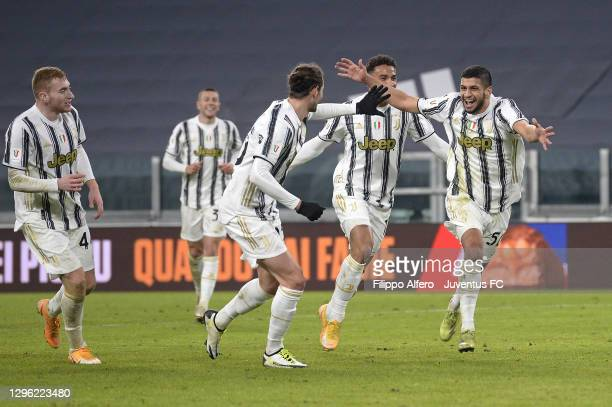 Hamza Rafia of Juventus celebrates after scoring his team's third goal with teammates Adrien Rabiot and Danilo during the Coppa Italia match between...